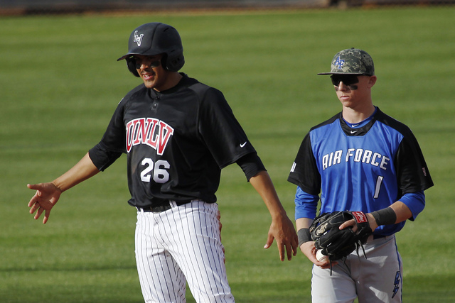UNLV's Edgar Montes (26) motions to his dug out after hitting a RBI double while taking on Air Force during their baseball game at Wilson Stadium in Las Vegas on March 1, 2014.  Air Force's Adam G ...