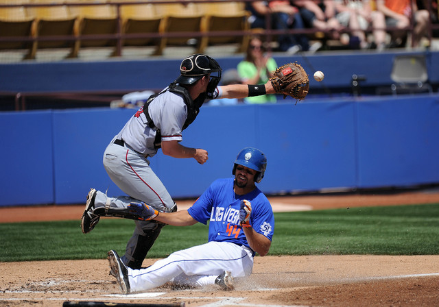 Las Vegas 51s base runner Cory Vaughn scores a run as Sacramento River Cats catcher Ben Turner fields the throw in the second inning of their Triple-A minor league baseball game at Cashman Field i ...