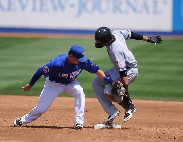 Sacramento River Cats base runner Ehire Adrianza reaches second base safely after hitting a double as Las Vegas 51s second baseman Matt Reynolds applies the tag in the third inning of their Triple ...