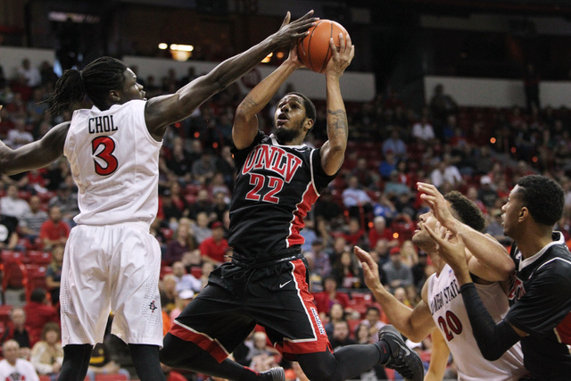 UNLV guard Jelan Kendrick is defended by San Diego State forward Angelo Chol during the first half of their Mountain West Conference tournament quarterfinal game Thursday, March 12, 2015, at the T ...
