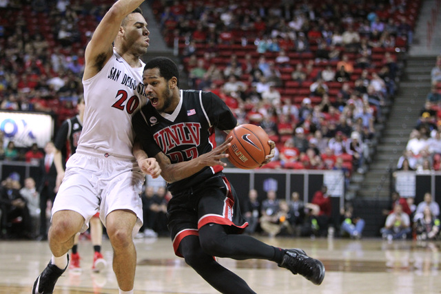 UNLV guard Jelan Kendrick is blocked by San Diego State forward J.J. O'Brien during the first half of their Mountain West Conference tournament quarterfinal game Thursday, March 12, 2015, at the T ...