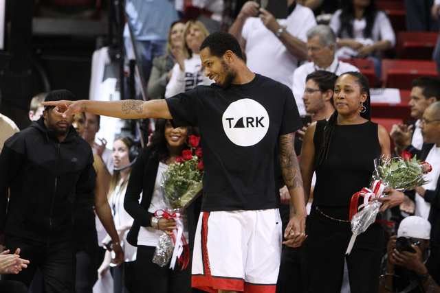 UNLV guard Jelan Kendrick points to a teammate while being escorted by his mother Denise Kendrick as part of senior night before their Mountain West Conference game against San Diego State Wednesd ...