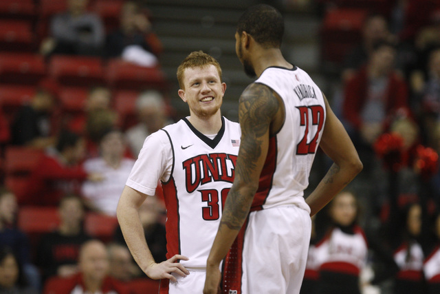 UNLV guard Dantley Walker, left, and UNLV guard Jelan Kendrick talk at midcourt during their Mountain West Conference game against San Jose State Saturday, Jan. 10, 2015, at the Thomas & Mack Cent ...