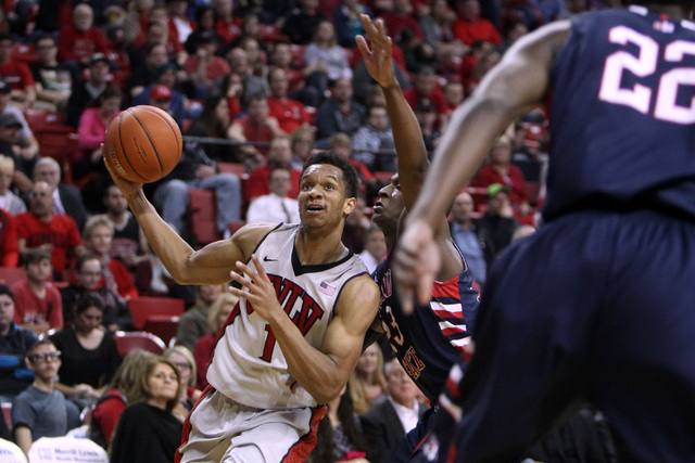 UNLV guard Rashad Vaughn drives past Fresno State guard Marvelle Harris during the first half of their Mountain West Conference game Tuesday, Feb. 10, 2015, at the Thomas & Mack Center. (Sam Morri ...