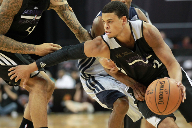 Sacramento's Ray McCallum (3) drives the ball against Washington during an NBA Summer League semifinal game at the Thomas & Mack Center in Las Vegas on Sunday, July 20, 2014. (Chase Stevens/Las Ve ...