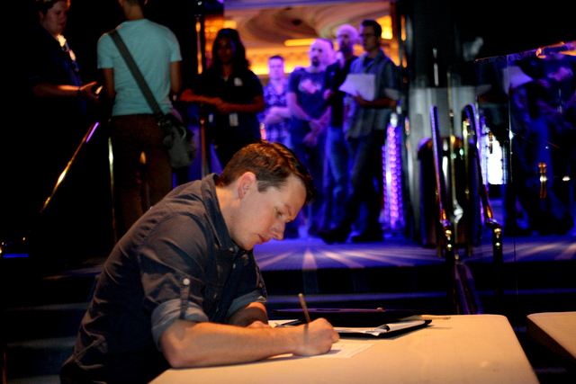As other hopefuls wait in line outside the Monte Carlo's Blue Man Theater, Greg Fellows, 33, of Las Vegas fills out an Open Call Audition Form before interviewing for an opportunity to become a Bl ...