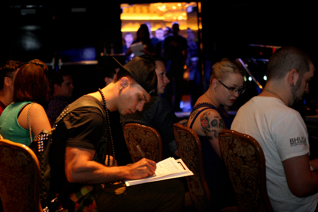 Cameron McKinley, 29, of Edmonton, Alberta, Canada completes an Open Call Audition Form before interviewing for an opportunity to become a Blue Man cast member. Wednesday, May 27, 2015 (Michael Qu ...