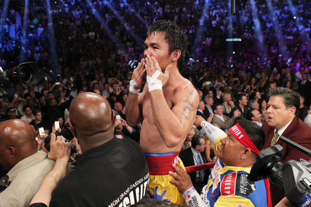 Manny Pacquiao thanks his fans after his welterweight unification boxing match against Floyd Mayweather Jr. at the MGM Grand Garden Arena in Las Vegas on Saturday, May 2, 2015. (Sam Morris/Las Veg ...