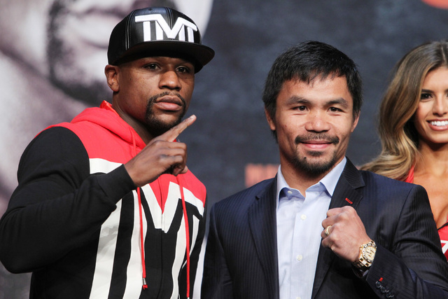 Floyd Mayweather Jr. and Manny Pacquiao pose during their news conference Wednesday, April 29, 2015 in the Ka Theater at the MGM Grand. (Sam Morris/Las Vegas Review-Journal) Follow Sam Morris on T ...