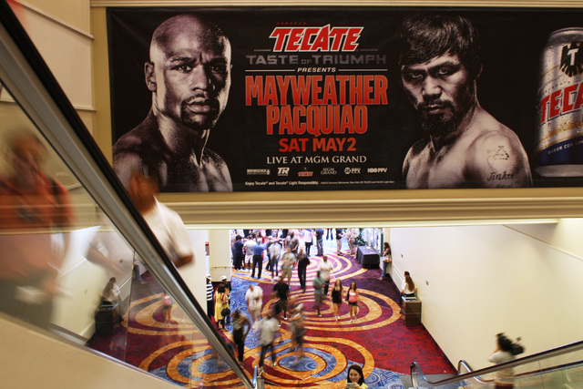 Fans head up the escalator for the Floyd Mayweather Jr. and Manny Pacquiao weigh in for their welterweight unification fight Friday, May 1, 2015, at the MGM Grand Garden Arena. (Sam Morris/Las Veg ...