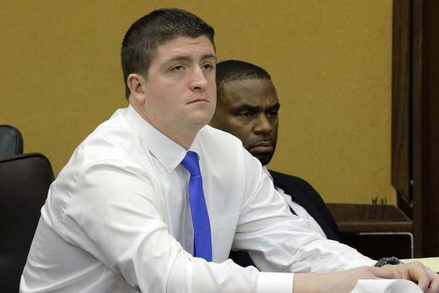 Cleveland police officer Michael Brelo (C) sits during his manslaughter trial in Cleveland, Ohio April 6, 2015.  Brelo is accused of fatally shooting two unarmed suspects after a long car chase in ...