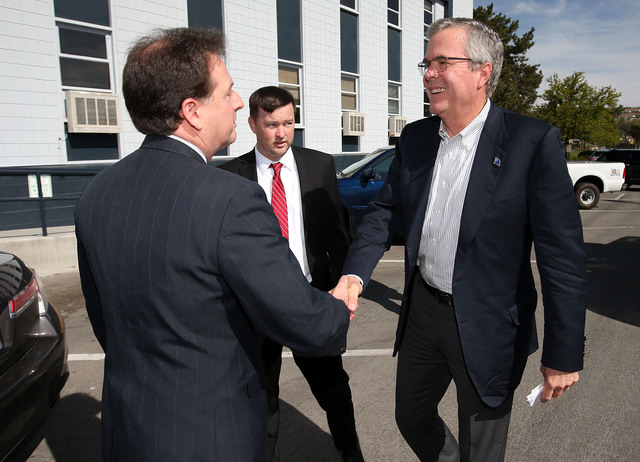 Former Lt. Gov. Brian Krolicki, left, greets former Florida Gov. Jeb Bush outside a town hall meeting in Reno, Nev., on Wednesday, May 13, 2015. (Cathleen Allison/Las Vegas Review-Journal)