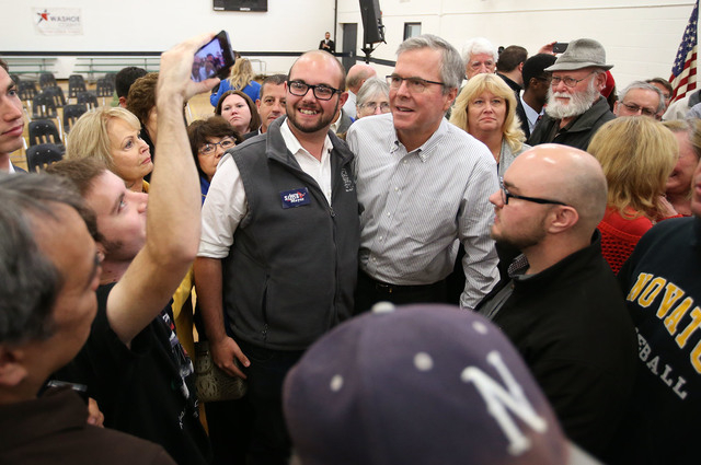 Former Florida Gov. Jeb Bush poses for photos with members of the audience following a town hall meeting in Reno, Nev., on Wednesday, May 13, 2015. (Cathleen Allison/Las Vegas Review-Journal)