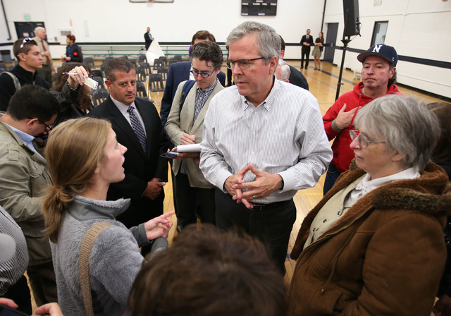 Former Florida Gov. Jeb Bush talks with University of Nevada, Reno student Ivy Ziedrich following a town hall meeting in Reno, Nev., on Wednesday, May 13, 2015. (Cathleen Allison/Las Vegas Review- ...