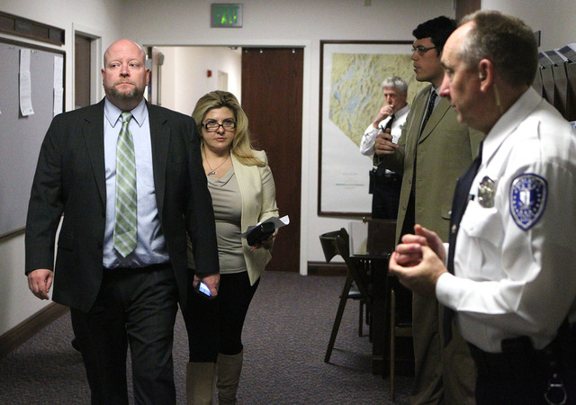 Legislative Counsel Bureau Director Rick Combs and Assemblywoman Michele Fiore, R-Las Vegas, walk to the Assembly chambers at the Legislative Building in Carson City, Nev., on Thursday, May 21, 20 ...