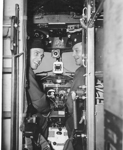 U.S. Army Air Corps officers, Col. Frank Krebs, left, and Maj. Howard Cannon, pose in the cockpit of a C-47 transport aircraft in this undated courtesy photo circa 1944. The two pilots where shot  ...