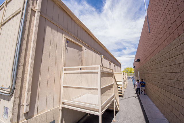 Students walk past portable classrooms that are used to help in overcrowding at Carolyn S. Reedom Elementary School in Las Vegas on Wednesday, May 20, 2015. (Joshua Dahl/Las Vegas Review-Journal)