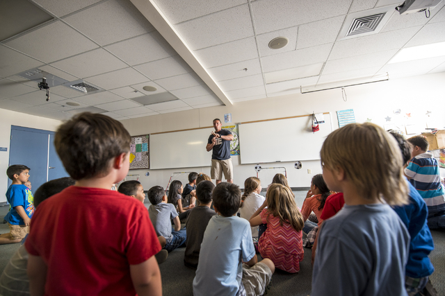Physical Education teacher Robert Glavan can sometimes have as many as three classes at once due to overcrowding at Carolyn S. Reedom Elementary School in Las Vegas on Wednesday, May 20, 2015. (Jo ...