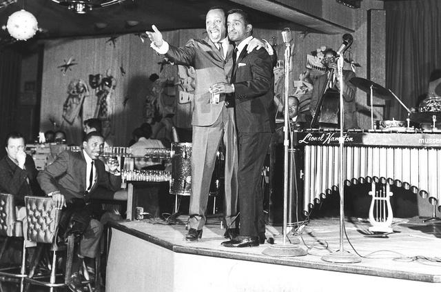 Performers Lionel Hampton, left, and Sammy Davis Jr. perform at the Riviera hotel-casino in Las Vegas, Dec. 2, 1963. (Las Vegas News Bureau)