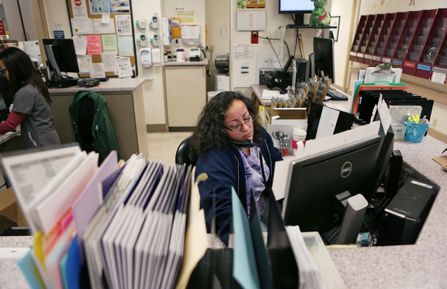 Benita Villasenor, unit secretary, works in the emergency room at UMC Children's Hospital of Nevada Thursday, May 7, 2015, in Las Vegas. The hospital's pediatric emergency room tends to 3-4 mental ...