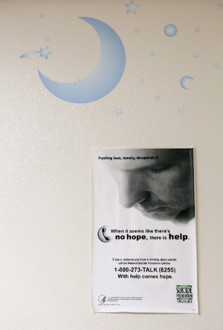 A poster containing information regarding suicide prevention is shown on the wall in a mental health evaluation room in the emergency room at UMC Children's Hospital of Nevada Thursday, May 7, 201 ...