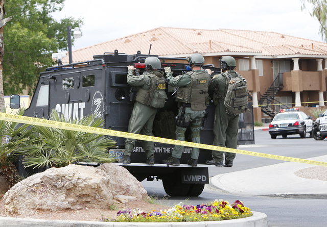 Las Vegas SWAT officers arrive at a barricade situation on Friday, May 8, 2015, at the Lake Tonopah Apartments in the 2100 block of Citrus Hills. Police said the constable was attempting to do bus ...