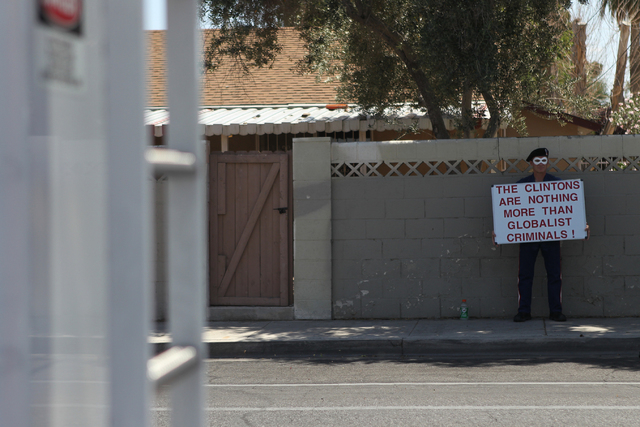 An unidentified protester stands outside of Rancho High School in North Las Vegas during a campaign visit by Democratic presidential candidate Hillary Clinton Tuesday, May 5, 2015. (Erik Verduzco/ ...