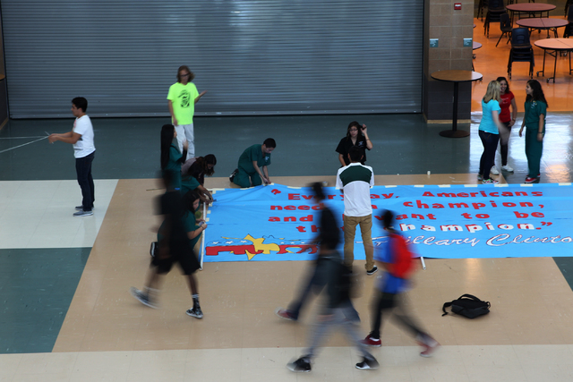 Students set up a banner inside Rancho High School in North Las Vegas for a campaign visit by Democratic presidential candidate Hillary Clinton Tuesday, May 5, 2015. (Erik Verduzco/Las Vegas Revie ...