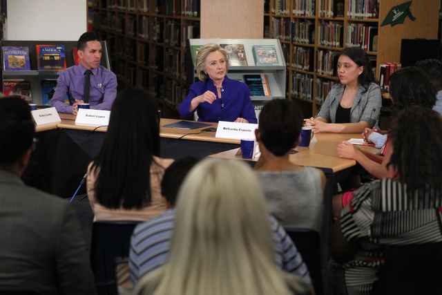 Democratic presidential candidate Hillary Clinton, center, speaks at Rancho High School in North Las Vegas during a round table discussion on immigration Tuesday, May 5, 2015. (Erik Verduzco/Las V ...