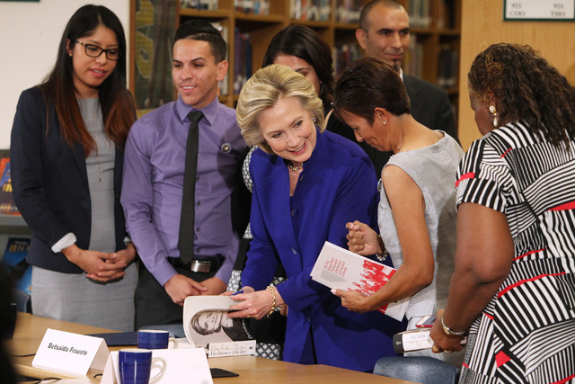 Hillary Clinton signs a copy of her book after a roundtable discussion on families and immigration Tuesday, May 5, 2015, at Rancho High School. (Sam Morris/Las Vegas Review-Journal) Follow Sam Mor ...