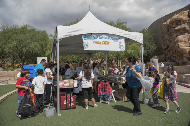 "Kids wander through book swap tent during the ""Flip Through Summer"" program at the Springs Preserve on Saturday, May 16, 2015. The event provides an opportunity for children to get excited about r ..."
