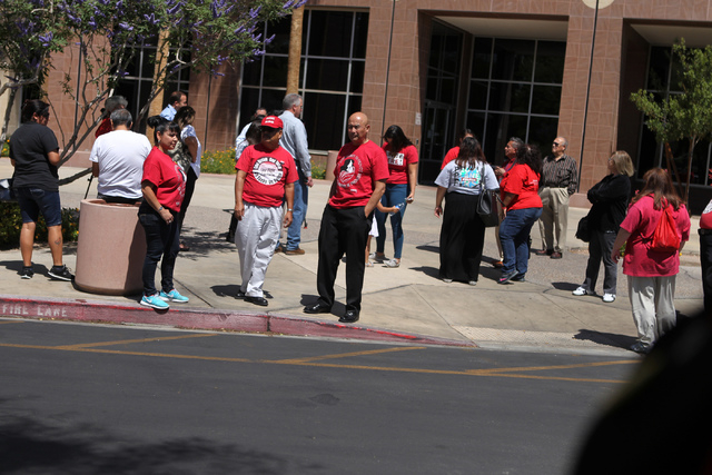 Community activists and allies stands outside of the Grant Sawyer Building, 555 E Washington Ave., before a press conference to demand Attorney General Adam Laxalt to remove Nevada from an anti-im ...