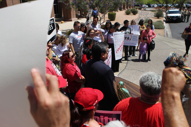 Community activists and allies participate during a press conference outside of the Grant Sawyer Building, 555 E Washington Ave., to demand Attorney General Adam Laxalt to remove Nevada from an an ...