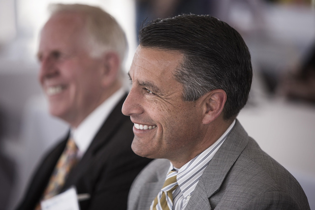 Nevada Gov. Brian Sandoval, right, and Michael Dermody, CEO of Dermody Properties, during the official groundbreaking of LogistiCenter Cheyenne, 4025 E. Cheyenne Ave on Tuesday, May 12, 2015. (Jef ...