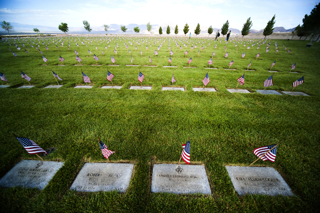 American flags adorn 25,896 graves at the Southern Nevada Memorial Veterans Cemetery in Boulder City on Saturday, May 23, 2015. Over 35 organizations took 45 minutes to complete the task of placin ...