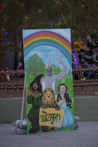 Francescha Mendoza, 9, sticks her head through a Wizard of Oz themed cut out during Opportunity Village's 60th birthday celebration at Opportunity Village in Las Vegas on Friday, May 15, 2015. (Jo ...