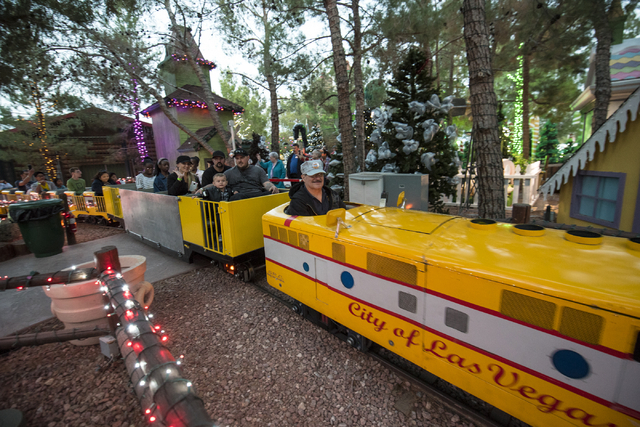 Guest enjoy train rides during Opportunity Village's 60th birthday celebration at Opportunity Village in Las Vegas on Friday, May 15, 2015. (Joshua Dahl/Las Vegas Review-Journal)