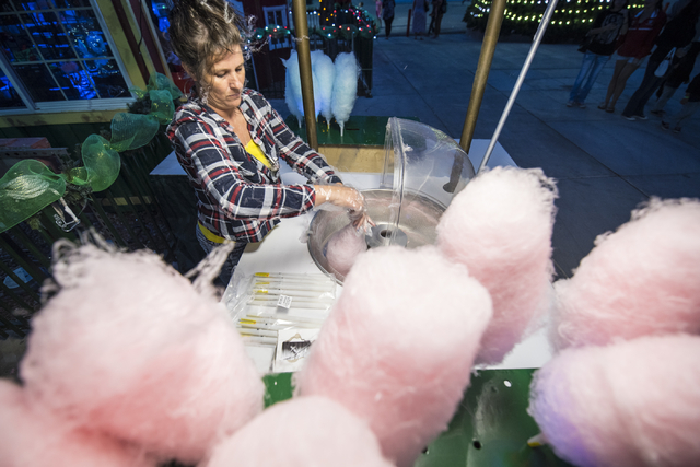 Justina Riddle spins cotton candy during Opportunity Village's 60th birthday celebration at Opportunity Village in Las Vegas on Friday, May 15, 2015. (Joshua Dahl/Las Vegas Review-Journal)