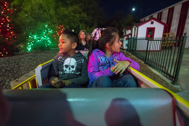 Sean Misipeka, 7, left, and Zoe Zaragoza, 8, enjoy the sights from the train during Opportunity Village's 60th birthday celebration at Opportunity Village in Las Vegas on Friday, May 15, 2015. (Jo ...