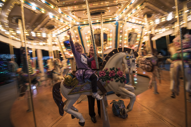 Jillian Hanna, 4, and her mother, Jeanne-Marie, enjoy the carousel during Opportunity Village's 60th birthday celebration at Opportunity Village in Las Vegas on Friday, May 15, 2015. (Joshua Dahl/ ...