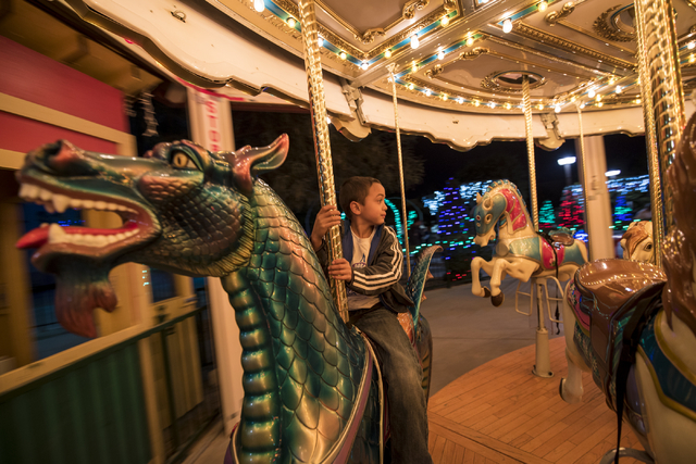 JP Tracy, 7, goes around on the carousel during Opportunity Village's 60th birthday celebration at Opportunity Village in Las Vegas on Friday, May 15, 2015. (Joshua Dahl/Las Vegas Review-Journal)