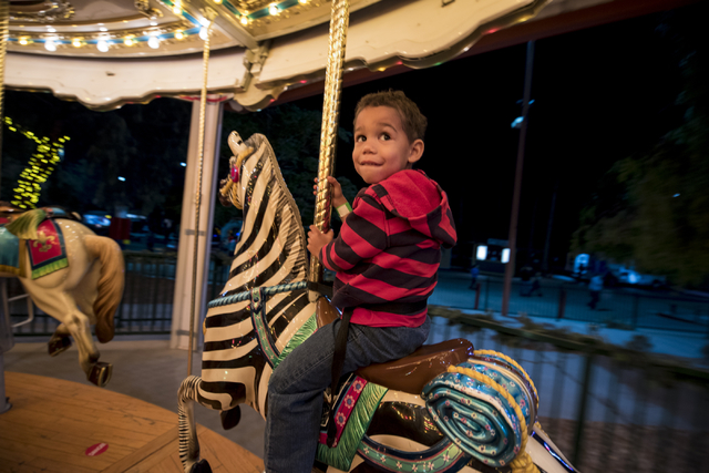Evan Fillinger, 4, flashes a grin on the carousel during Opportunity Village's 60th birthday celebration at Opportunity Village in Las Vegas on Friday, May 15, 2015. (Joshua Dahl/Las Vegas Review- ...