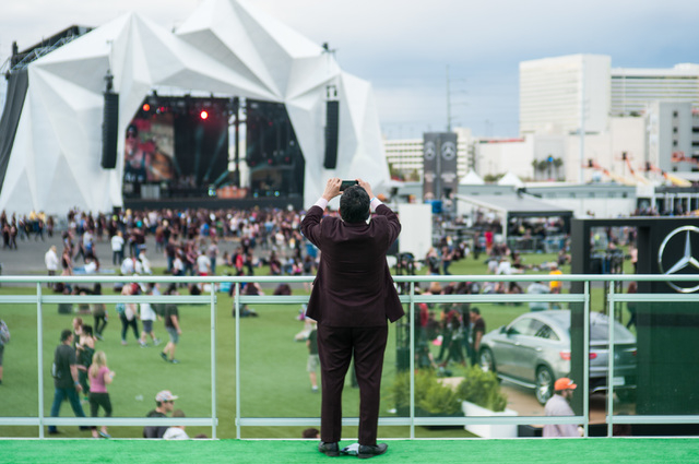 A man takes a photo from the outdoor VIP area during the Rock in Rio USA music festival in Las Vegas on Saturday, May 9, 2015. (Chase Stevens/Las Vegas Review-Journal) Follow Chase Stevens on Twit ...