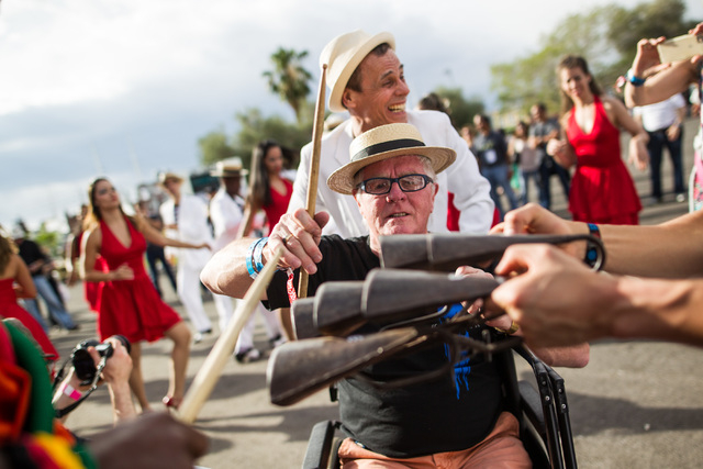 Jim Thomson, center, helps plays an instrument as dancers and musicians perform at the Rock in Rio USA music festival in Las Vegas on Saturday, May 9, 2015. (Chase Stevens/Las Vegas Review-Journal ...