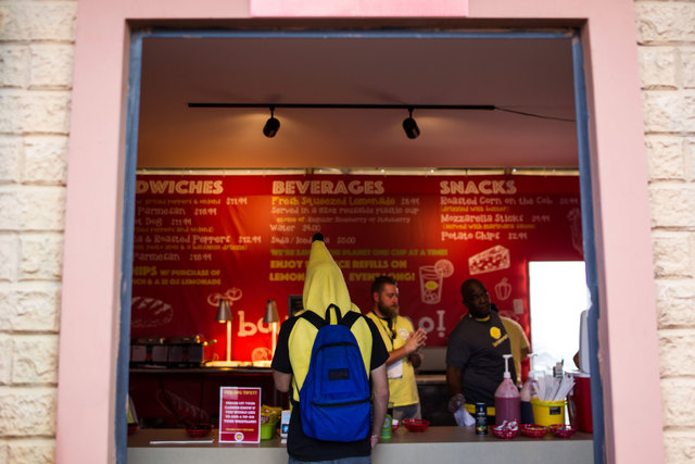 Noah Marogi buys a drink from a food vendor at the Rock in Rio USA music festival in Las Vegas on Saturday, May 9, 2015. (Chase Stevens/Las Vegas Review-Journal) Follow Chase Stevens on Twitter @c ...