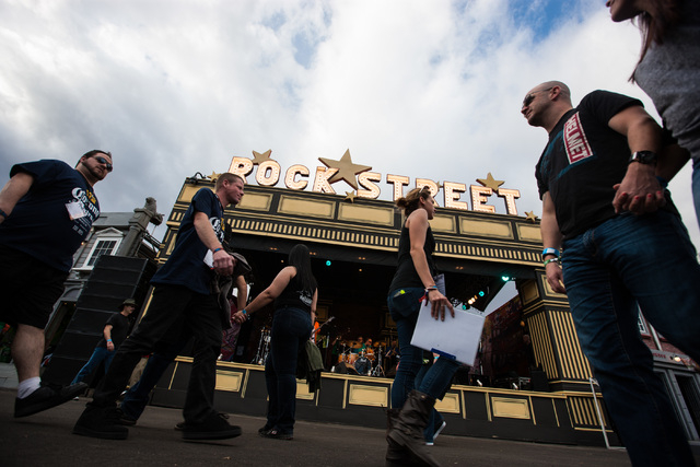 People pass by the Rock Street UK stage at the Rock in Rio USA music festival in Las Vegas on Saturday, May 9, 2015. (Chase Stevens/Las Vegas Review-Journal) Follow Chase Stevens on Twitter @csste ...