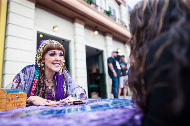 Samina Ocean, left, performs a fortune telling for Sandra Garibay at the Rock in Rio USA music festival in Las Vegas on Saturday, May 9, 2015. (Chase Stevens/Las Vegas Review-Journal) Follow Chase ...