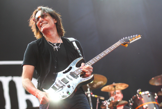 Guitarist Steve Vai joins Sepultura on the Mercedes-Benz Evolution stage during the Rock in Rio USA music festival in Las Vegas on Saturday, May 9, 2015. (Chase Stevens/Las Vegas Review-Journal) F ...
