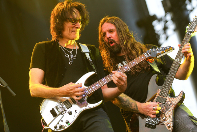 Guitarist Steve Vai joins Sepultura, including Andreas Kisser, on stageon the Mercedes-Benz Evolution stage during the Rock in Rio USA music festival in Las Vegas on Saturday, May 9, 2015. (Chase  ...