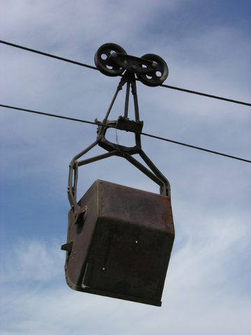 Ore buckets still hang from a tramline that runs above the town of Pioche. (Courtesy/Pioche Chamber of Commerce)